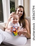 mother with six month old baby... | Shutterstock . vector #38363794