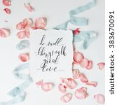 Stock photo quote do small things with great love written in calligraphy style on paper with pink petals and 383670091