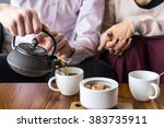 couple drinking tea in the cafe | Shutterstock . vector #383735911