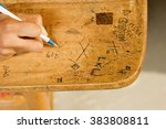 student drawing on desk | Shutterstock . vector #383808811