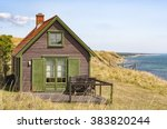 A Small Wooden House On The...