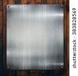 silver metal plaque on wood... | Shutterstock . vector #383828569