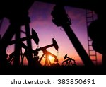 oil pumps producing oil at dusk.... | Shutterstock . vector #383850691