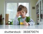 cute little boy in pyjama still ... | Shutterstock . vector #383870074