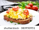 scrambled eggs with tomato on... | Shutterstock . vector #383950951