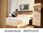 asian hotel maid making bed ... | Shutterstock . vector #383952535