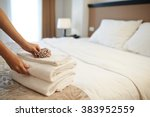 hands of hotel maid putting... | Shutterstock . vector #383952559