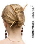 Woman coiffure with sticks. Isolated on white. - stock photo