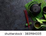 green tea and sushi chopsticks... | Shutterstock . vector #383984335