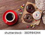 Donuts And Coffee On Wooden...