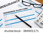 insurance claim form with pen... | Shutterstock . vector #384001171