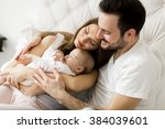 happy family with newborn baby | Shutterstock . vector #384039601