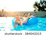 couple in inflatable ring in... | Shutterstock . vector #384043315