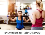 woman exercising in gym ... | Shutterstock . vector #384043909