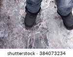 Child Steps On Frozen Puddle...