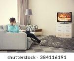 young handsome man watching tv... | Shutterstock . vector #384116191