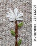 knitted white flower on a gray ...   Shutterstock . vector #384132709