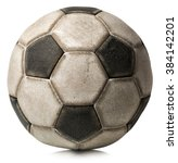 Small photo of Detail of an old black and white soccer ball (Football) isolated on white background