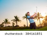 man golf shot from sand bunker... | Shutterstock . vector #384161851