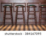 row of wooden stools in front... | Shutterstock . vector #384167095