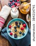 bowl with oat porridge and... | Shutterstock . vector #384214741