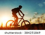 Rider On Mountain Bicycle It...