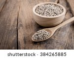 pepper in a bowl on wooden... | Shutterstock . vector #384265885