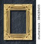 gold frame on black slate... | Shutterstock . vector #384285655