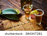 tequila shot with lime and sea... | Shutterstock . vector #384347281