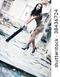 Young woman fashion in a ruined building. Camera angle view. - stock photo