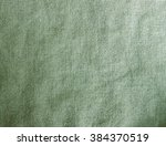 green linen fabric background | Shutterstock . vector #384370519