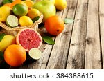 Citrus Fruits On A Brown Woode...