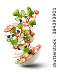 flying salad isolated on white... | Shutterstock . vector #384393901