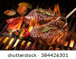 beef steaks on the grill with... | Shutterstock . vector #384426301