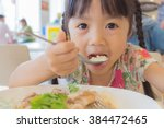Asian Child Eat In The Food...