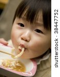 a little girl is eating a meal. | Shutterstock . vector #38447752