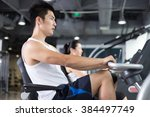 people working out in modern gym | Shutterstock . vector #384497749