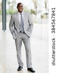 Small photo of portrait young afro american businessman standing in office