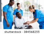 Small photo of happy female doctor greeting disabled patient in hospital