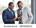 happy african businessmen using ... | Shutterstock . vector #384568261