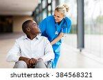 caring female nurse talking to... | Shutterstock . vector #384568321