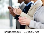 business group applauding... | Shutterstock . vector #384569725