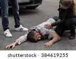 woman checking if man hit by a... | Shutterstock . vector #384619255