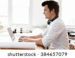 young businessman in office | Shutterstock . vector #384657079
