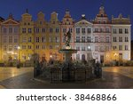 Old town in Gdansk houses of the Neptune fountain in the background. - stock photo