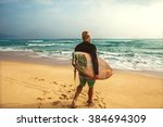 surfer at the sea is standing... | Shutterstock . vector #384694309