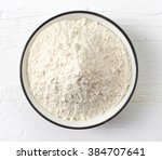 bowl of white flour on white... | Shutterstock . vector #384707641