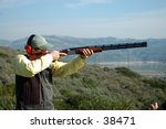 A Man Shooting A Shotgun On Th...