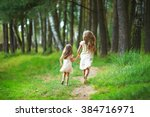 two sisters run through the... | Shutterstock . vector #384716971
