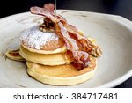 stack of delicious pancakes... | Shutterstock . vector #384717481